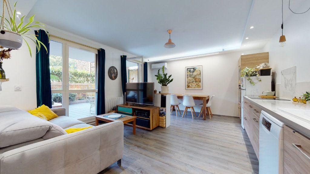 Appartement à vendre 3 65.7m2 à Lyon 7 vignette-1