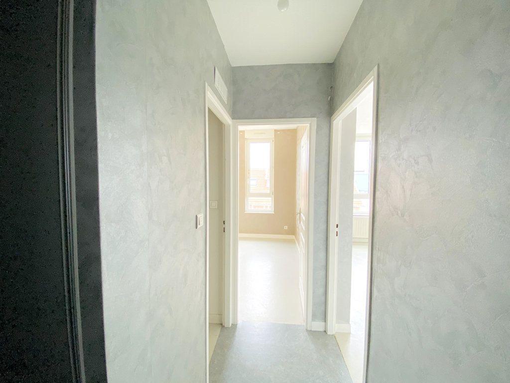 Appartement à vendre 6 128.43m2 à Nancy vignette-9