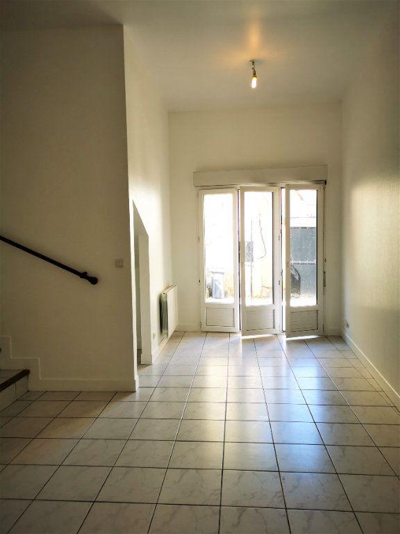 Appartement à louer 2 49.34m2 à La Ville-du-Bois vignette-1