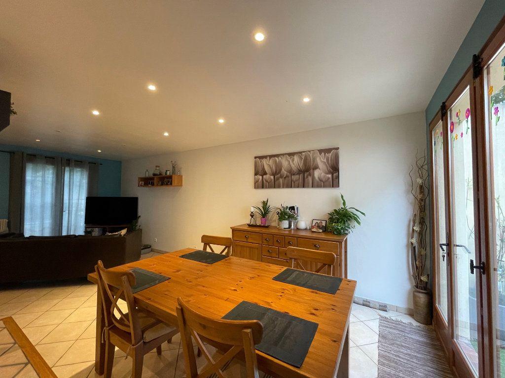 Maison à vendre 4 122m2 à Romainville vignette-3