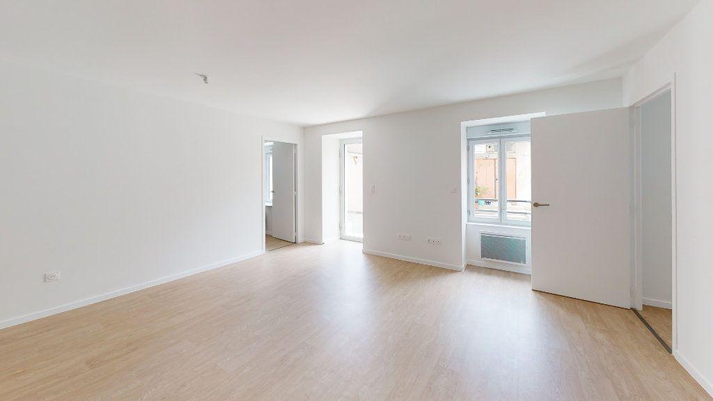 Appartement à louer 3 62.09m2 à Saint-Étienne vignette-1
