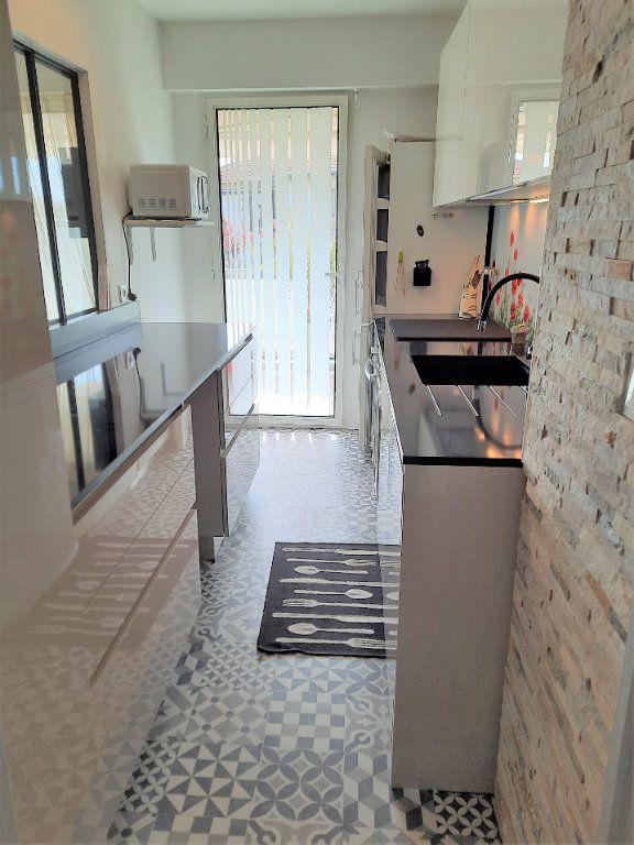 Appartement à vendre 2 52m2 à Saint-Laurent-du-Var vignette-5