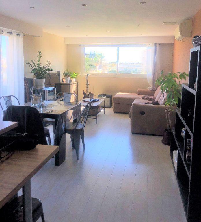 Appartement à vendre 3 67m2 à Saint-Laurent-du-Var vignette-3