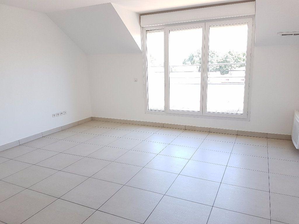 Appartement à louer 3 58.57m2 à Meaux vignette-2
