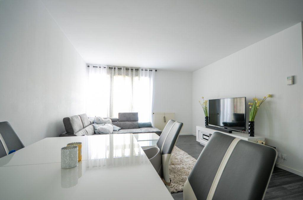 Appartement à vendre 3 67.41m2 à Saint-Ouen-l'Aumône vignette-2