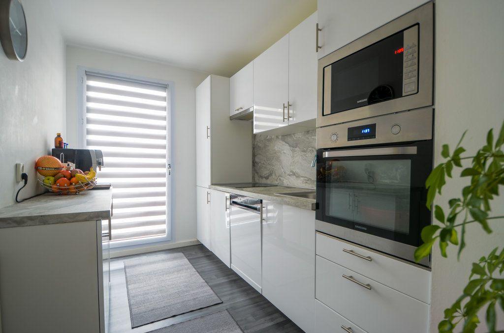 Appartement à vendre 3 67.41m2 à Saint-Ouen-l'Aumône vignette-4