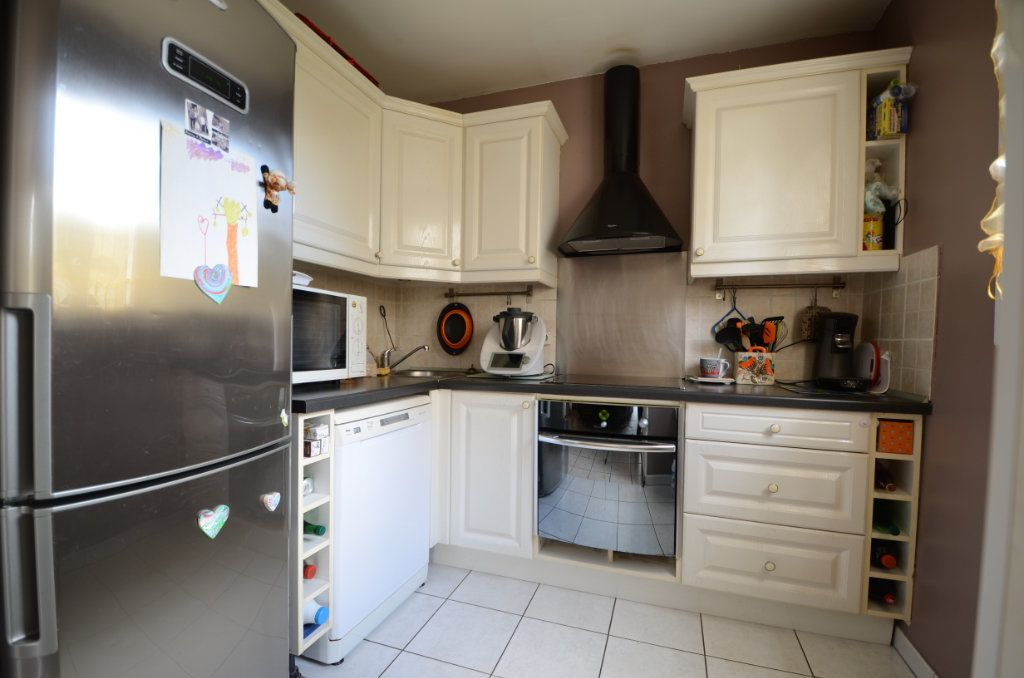 Appartement à vendre 3 65.8m2 à Saint-Ouen-l'Aumône vignette-4