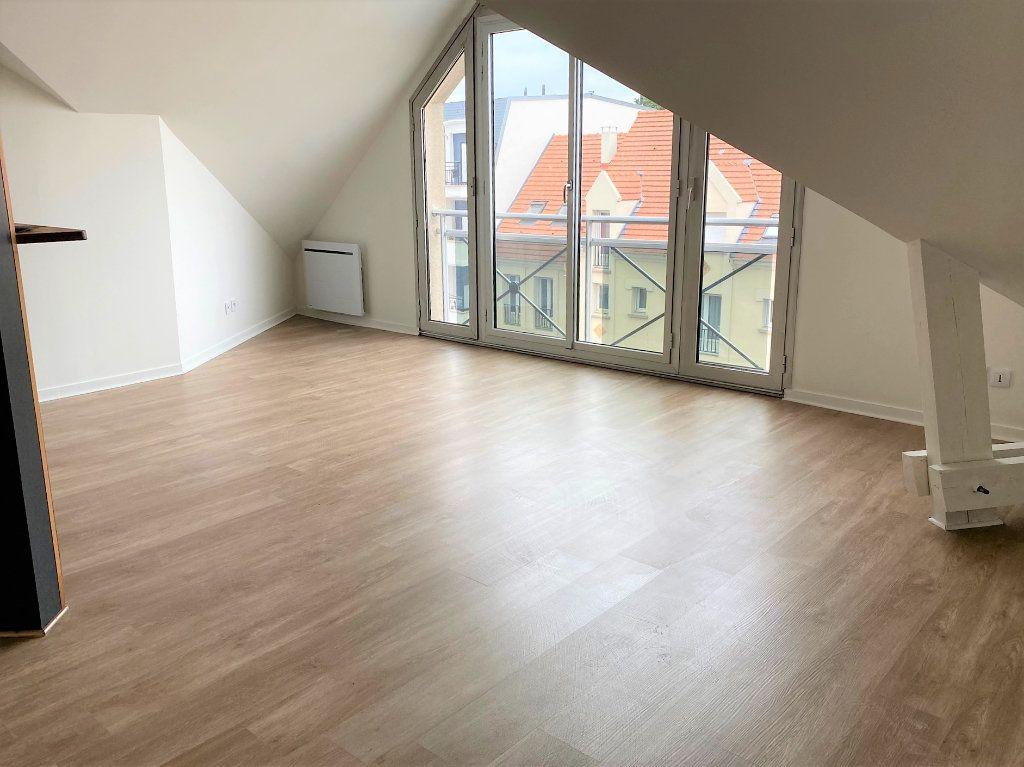 Appartement à louer 2 30.84m2 à Sainte-Geneviève-des-Bois vignette-1