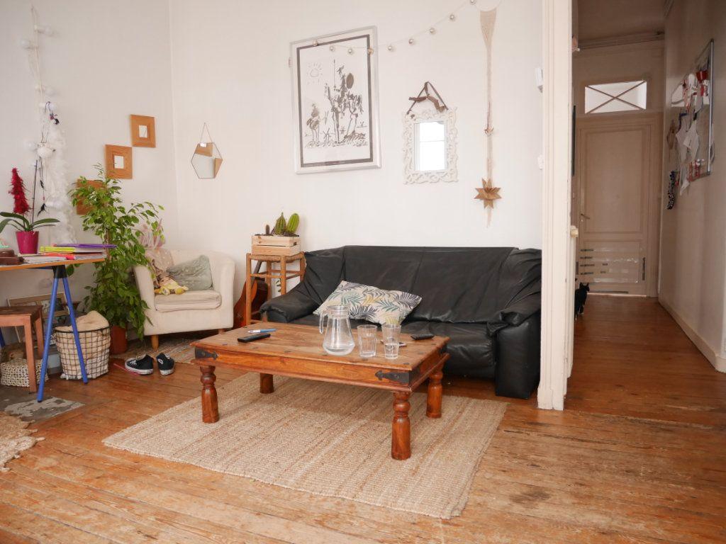 Appartement à vendre 3 59m2 à Bordeaux vignette-1