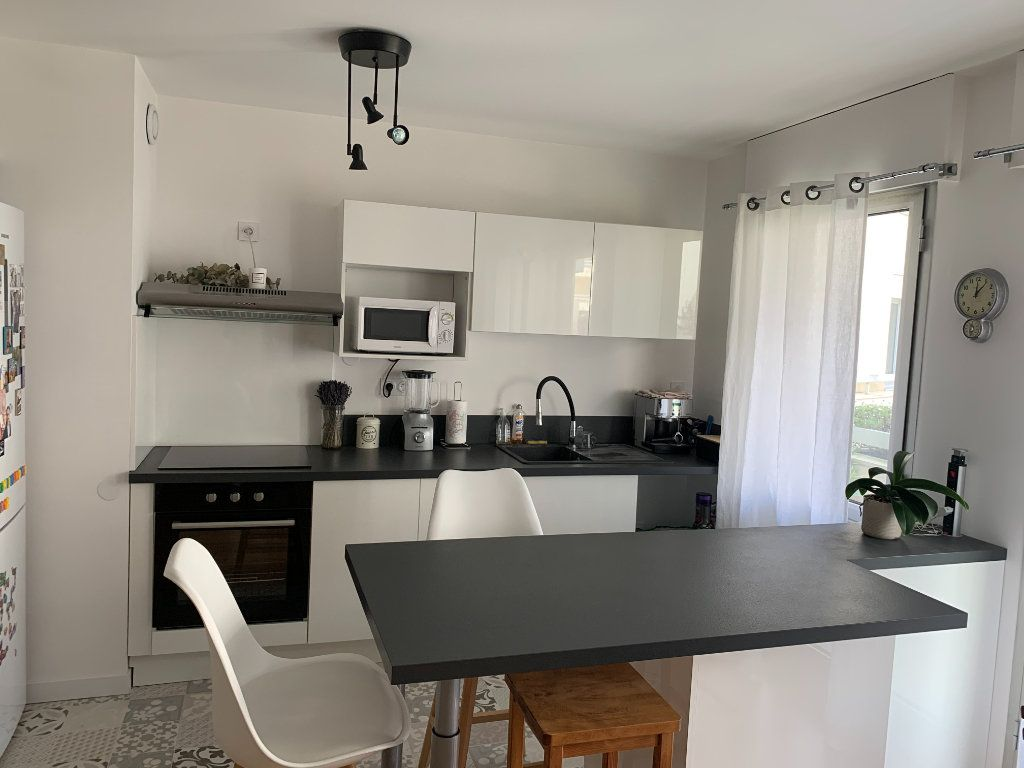 Appartement à vendre 3 66m2 à Bordeaux vignette-2