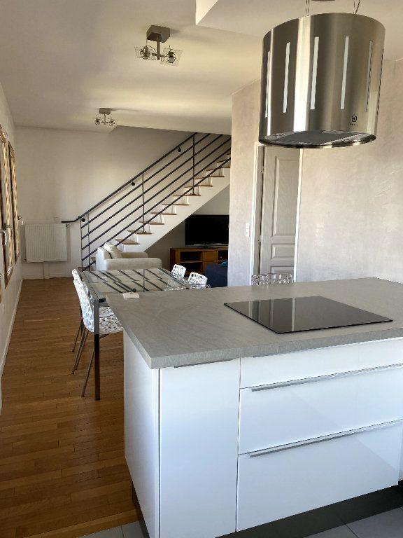 Appartement à louer 3 69.5m2 à Boulogne-Billancourt vignette-2