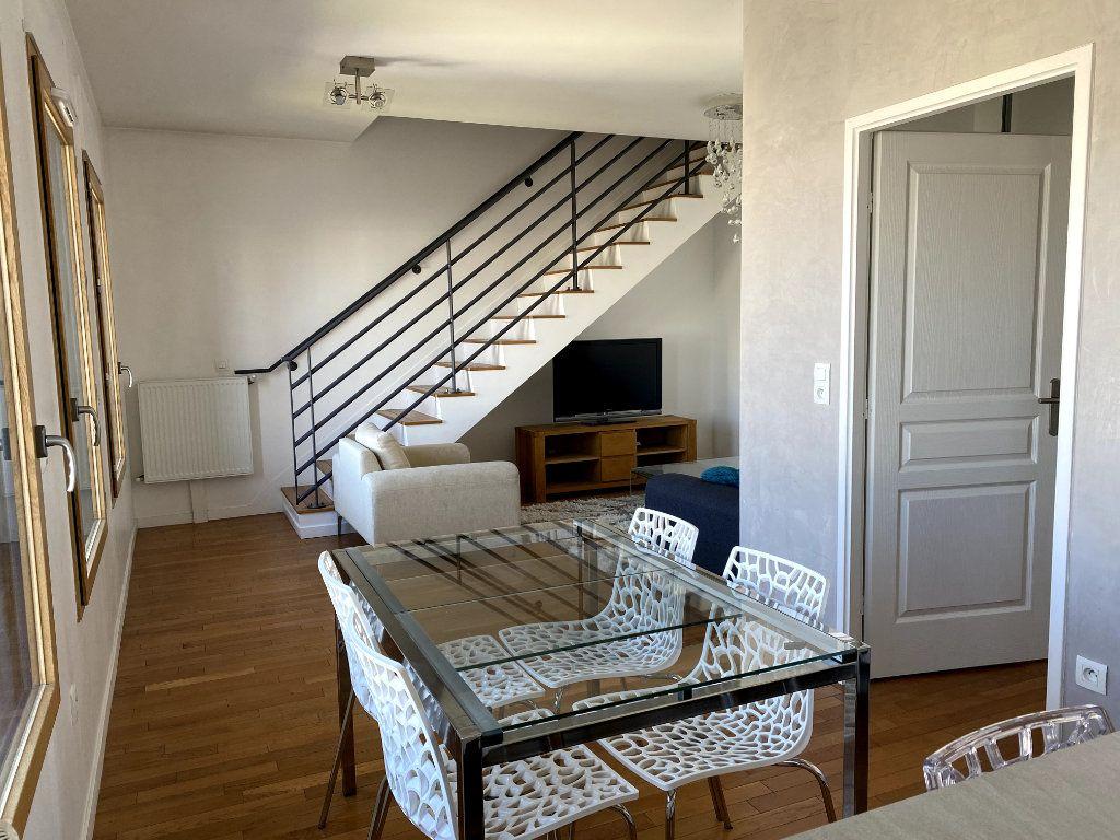 Appartement à louer 3 69.5m2 à Boulogne-Billancourt vignette-4