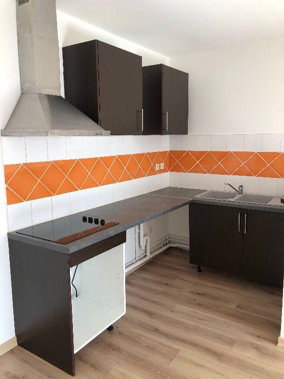 Appartement à vendre 2 60m2 à Saint-Denis vignette-2