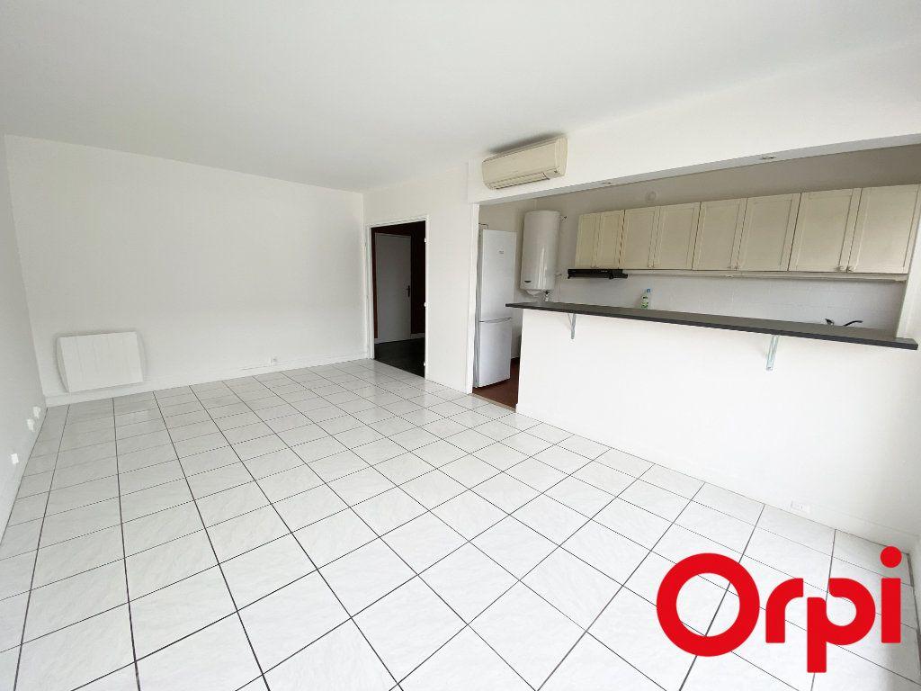 Appartement à vendre 3 65.73m2 à Soisy-sur-Seine vignette-1