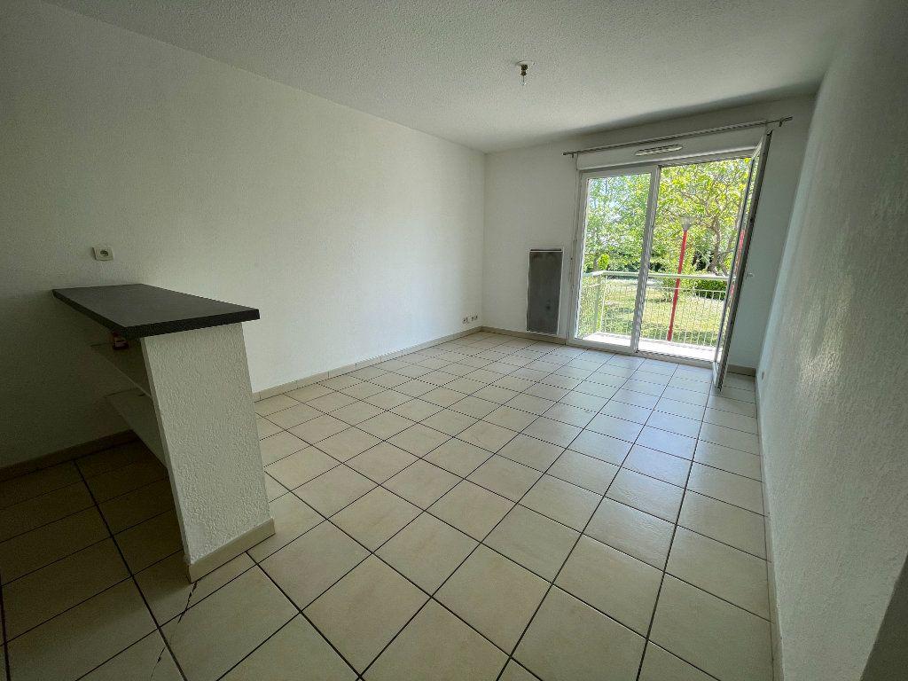 Appartement à vendre 2 36m2 à Bruguières vignette-1