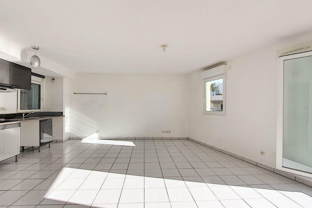 Appartement à vendre 3 66m2 à Juan-les-Pins - Antibes vignette-4