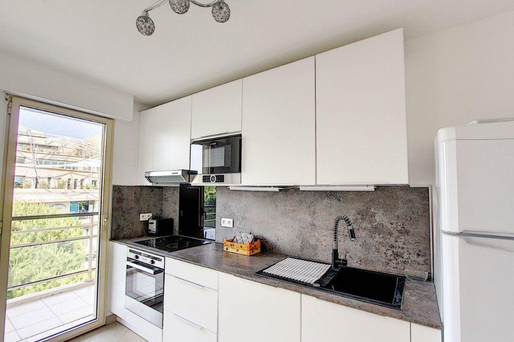 Appartement à vendre 3 66m2 à Juan-les-Pins - Antibes vignette-5