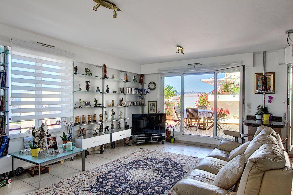 Appartement à vendre 3 83m2 à Juan-les-Pins - Antibes vignette-2