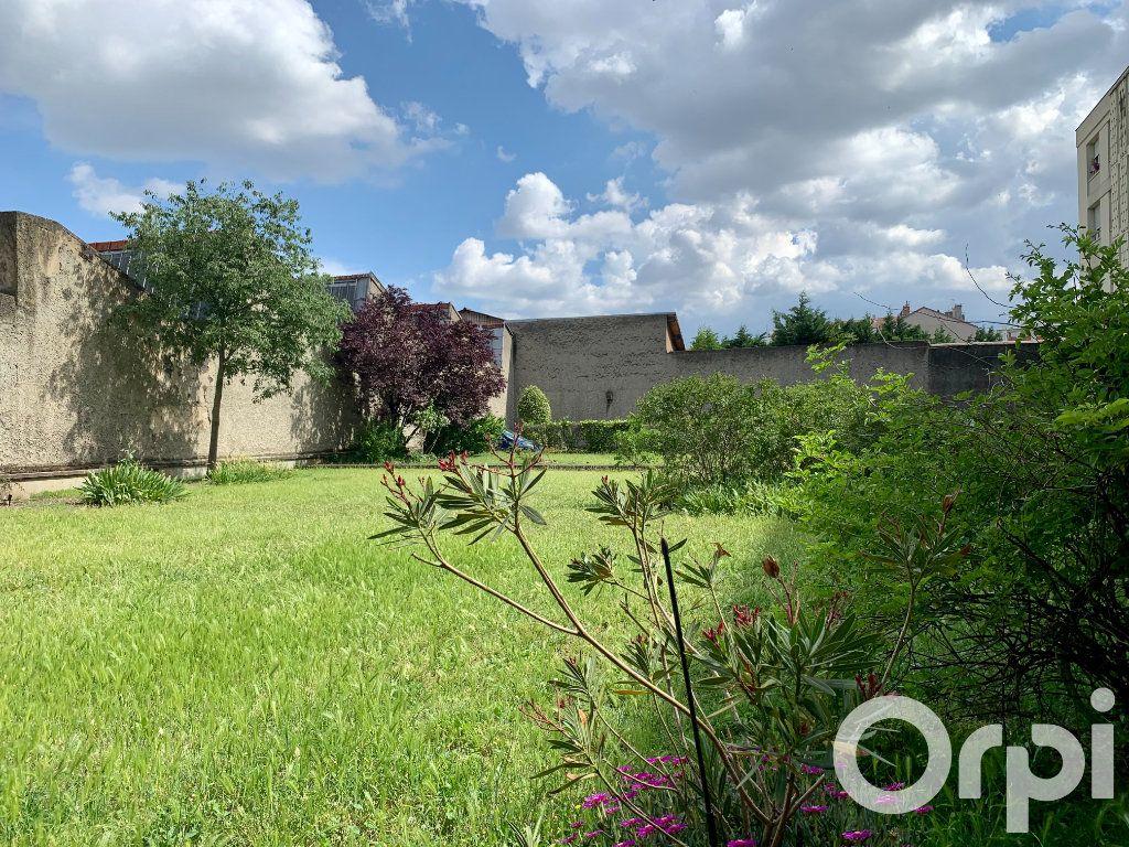 Appartement à vendre 4 96.79m2 à Villeurbanne vignette-8
