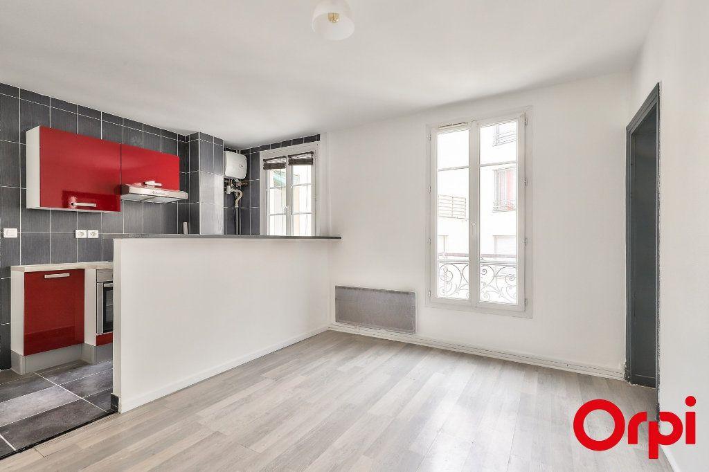 Appartement à vendre 2 37m2 à Paris 18 vignette-1
