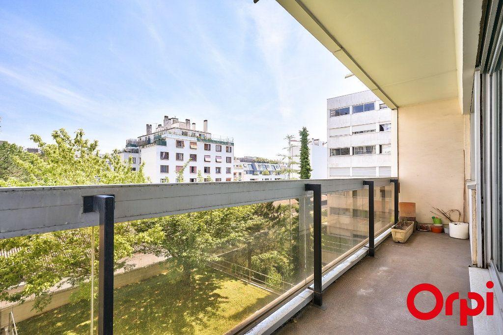 Appartement à vendre 3 64.42m2 à Paris 15 vignette-2
