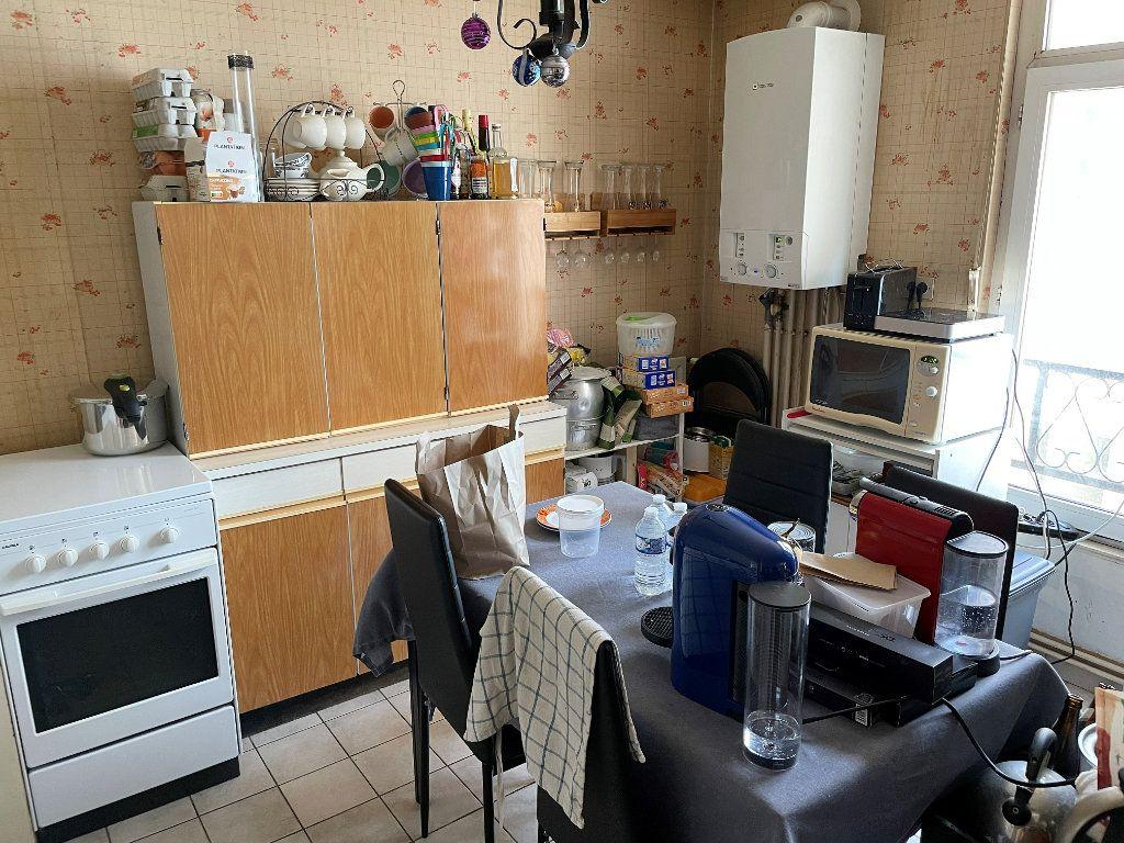 Appartement à vendre 2 47m2 à Reims vignette-2