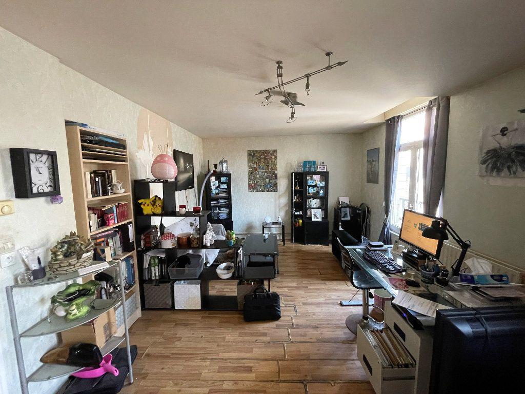 Appartement à vendre 2 50.09m2 à Reims vignette-1