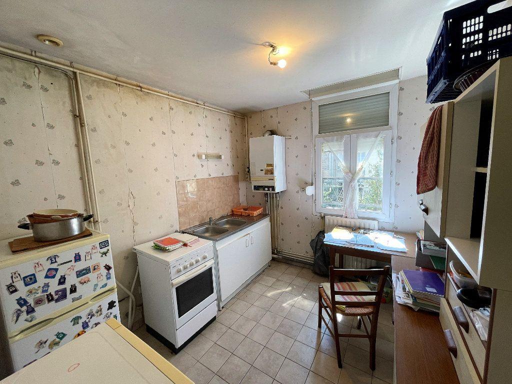 Appartement à vendre 3 57m2 à Reims vignette-2