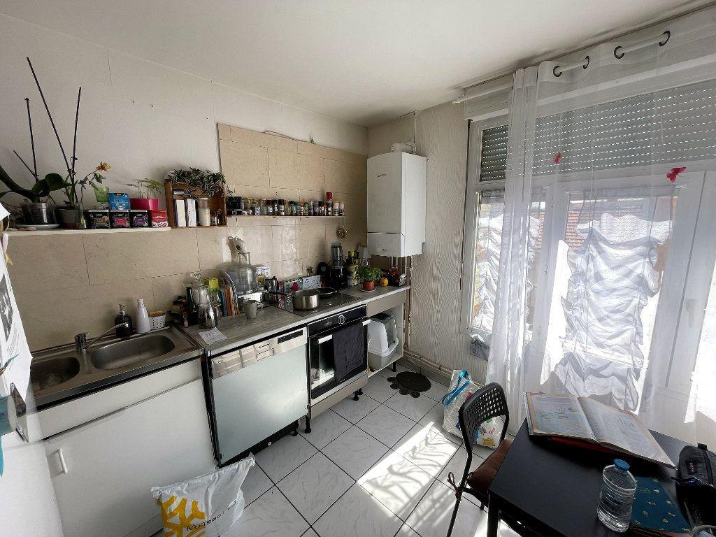 Appartement à vendre 3 55.12m2 à Reims vignette-4