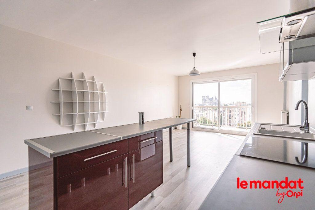 Appartement à louer 3 57.66m2 à Reims vignette-2