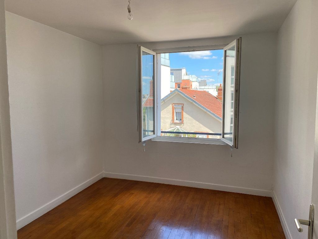 Appartement à vendre 4 85m2 à Saint-Jean-de-la-Ruelle vignette-5