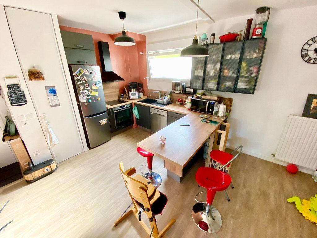 Appartement à vendre 3 67.2m2 à Noisy-le-Sec vignette-3