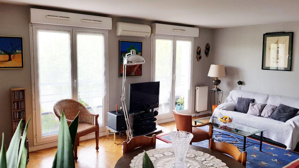 Appartement à vendre 3 64.3m2 à Saint-Gratien vignette-3
