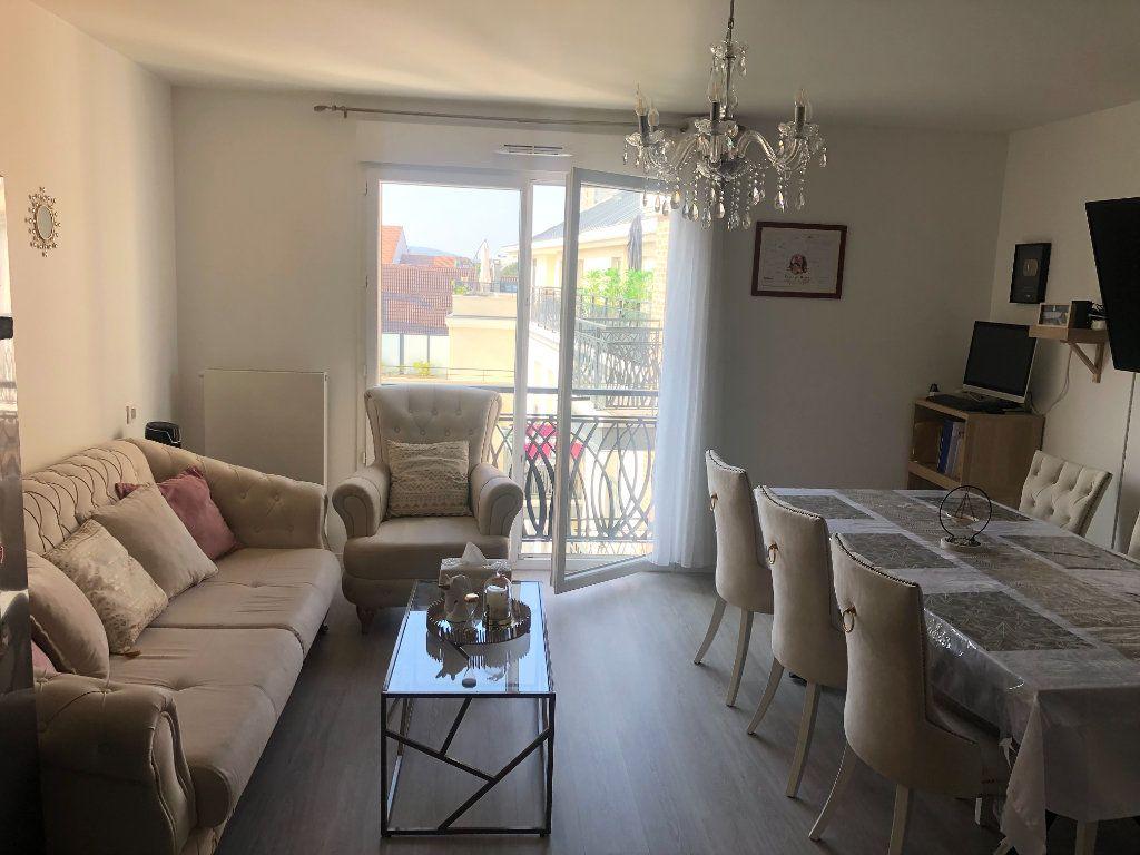 Appartement à vendre 2 49.78m2 à Saint-Gratien vignette-1