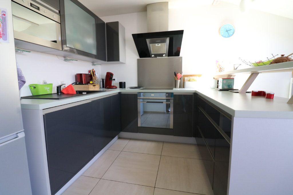 Appartement à vendre 3 54.96m2 à Saint-Vincent-de-Tyrosse vignette-2