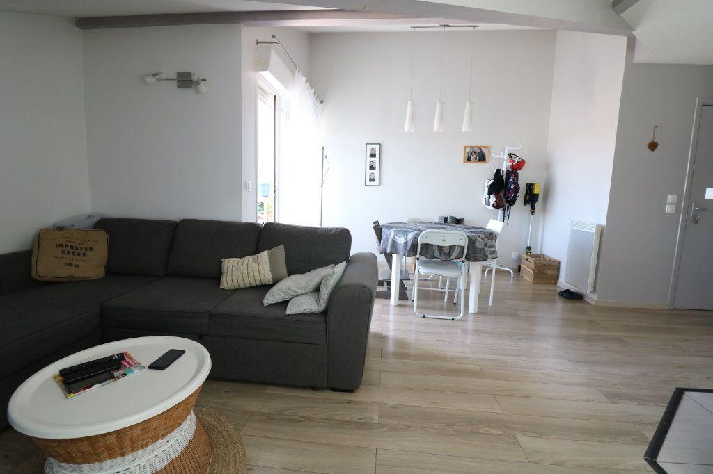 Appartement à vendre 3 54.96m2 à Saint-Vincent-de-Tyrosse vignette-4