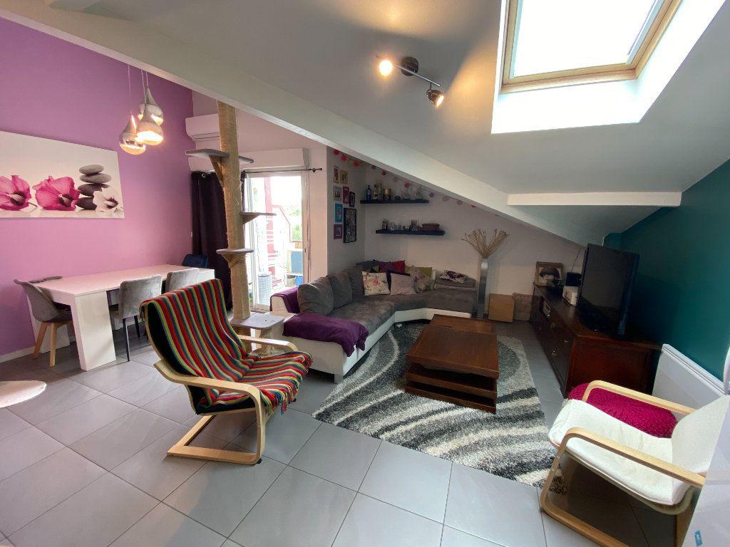 Appartement à vendre 3 59.68m2 à Saint-Vincent-de-Tyrosse vignette-1