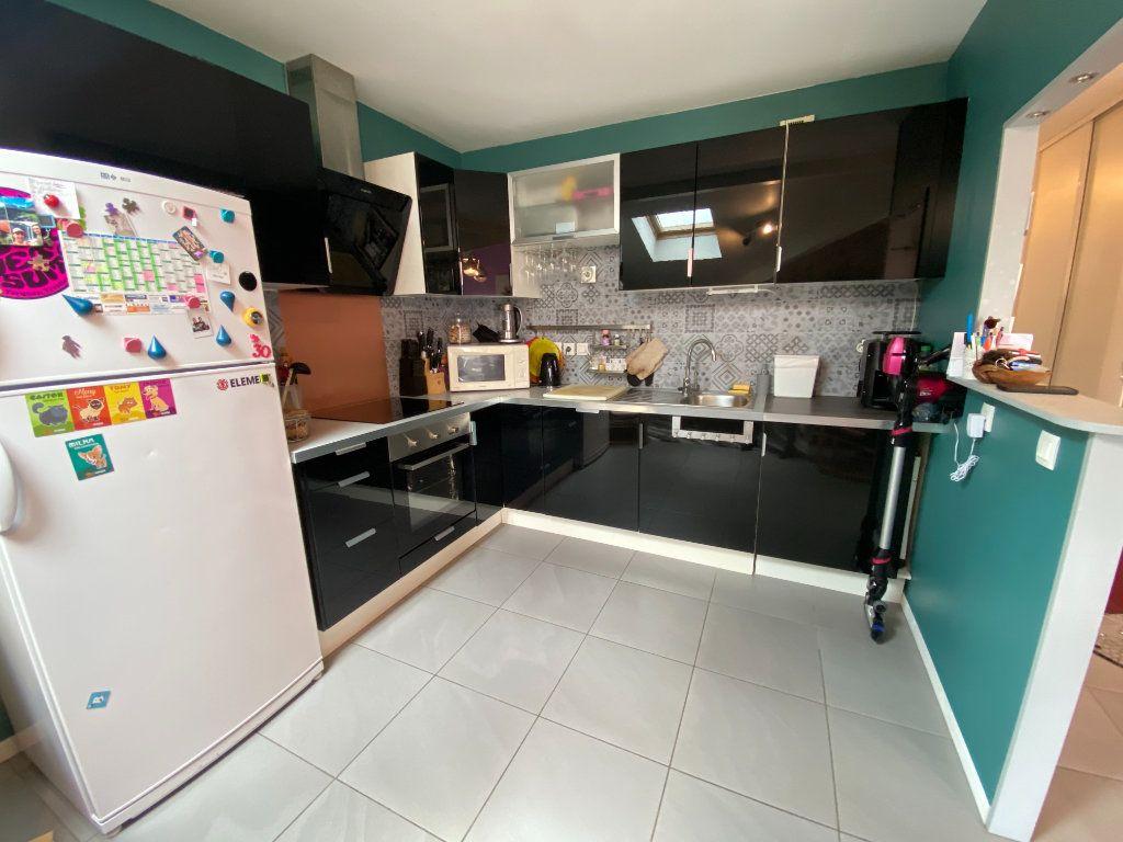 Appartement à vendre 3 59.68m2 à Saint-Vincent-de-Tyrosse vignette-4