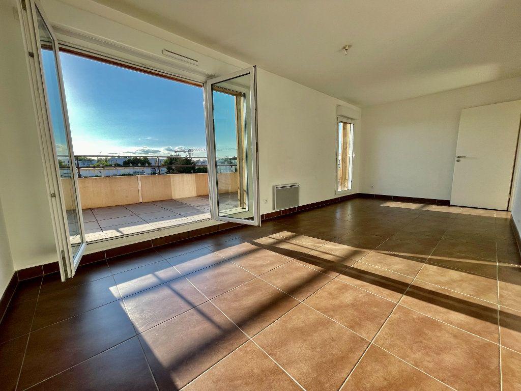 Appartement à vendre 3 58.9m2 à Montpellier vignette-2
