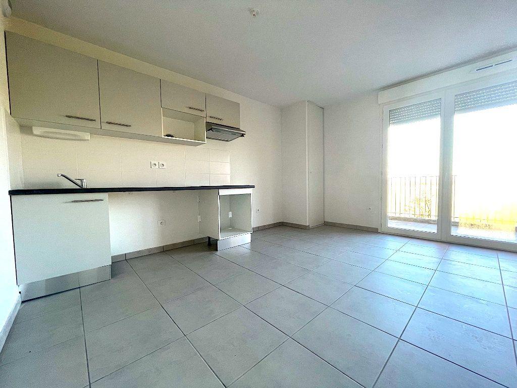 Appartement à vendre 3 60m2 à Castelginest vignette-2
