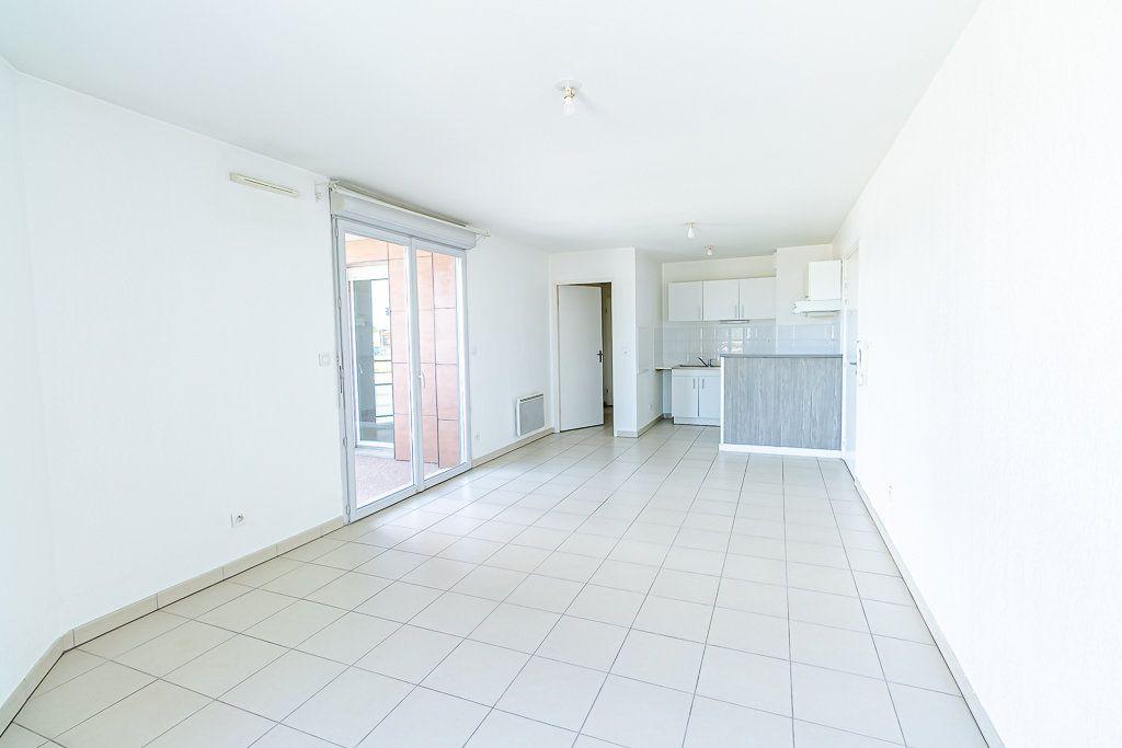 Appartement à vendre 3 57.31m2 à Toulouse vignette-1