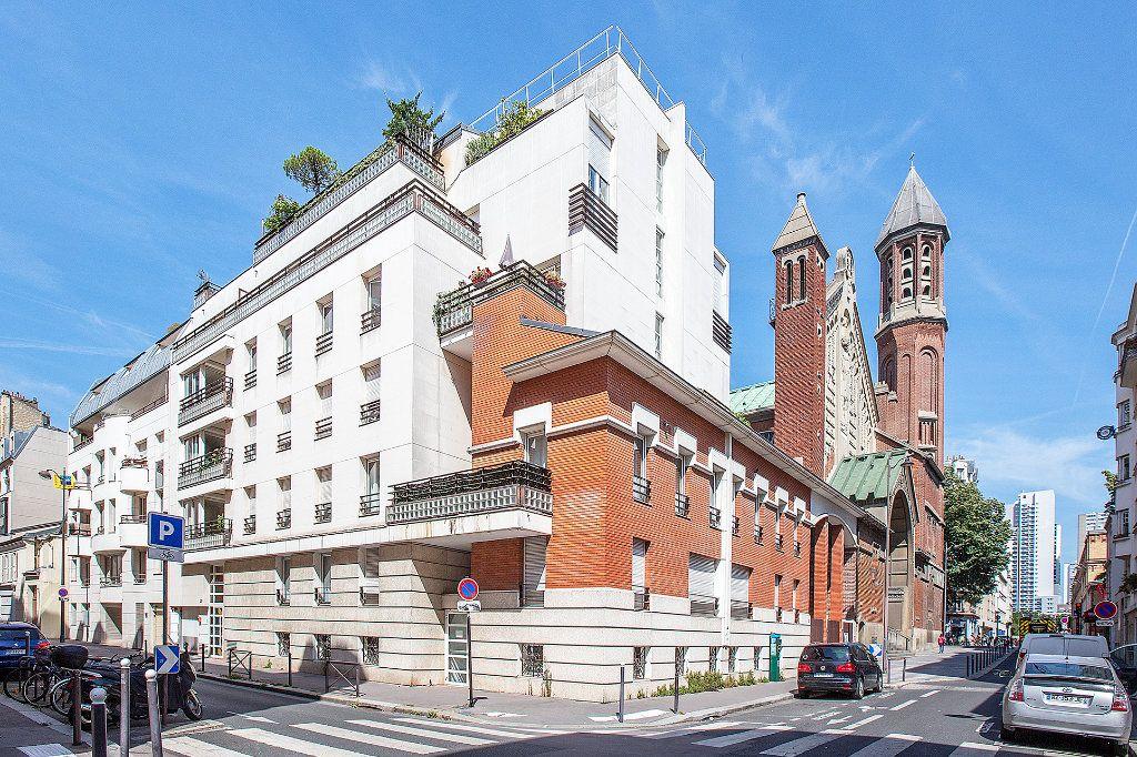 Appartement à vendre 2 56.63m2 à Paris 15 vignette-1