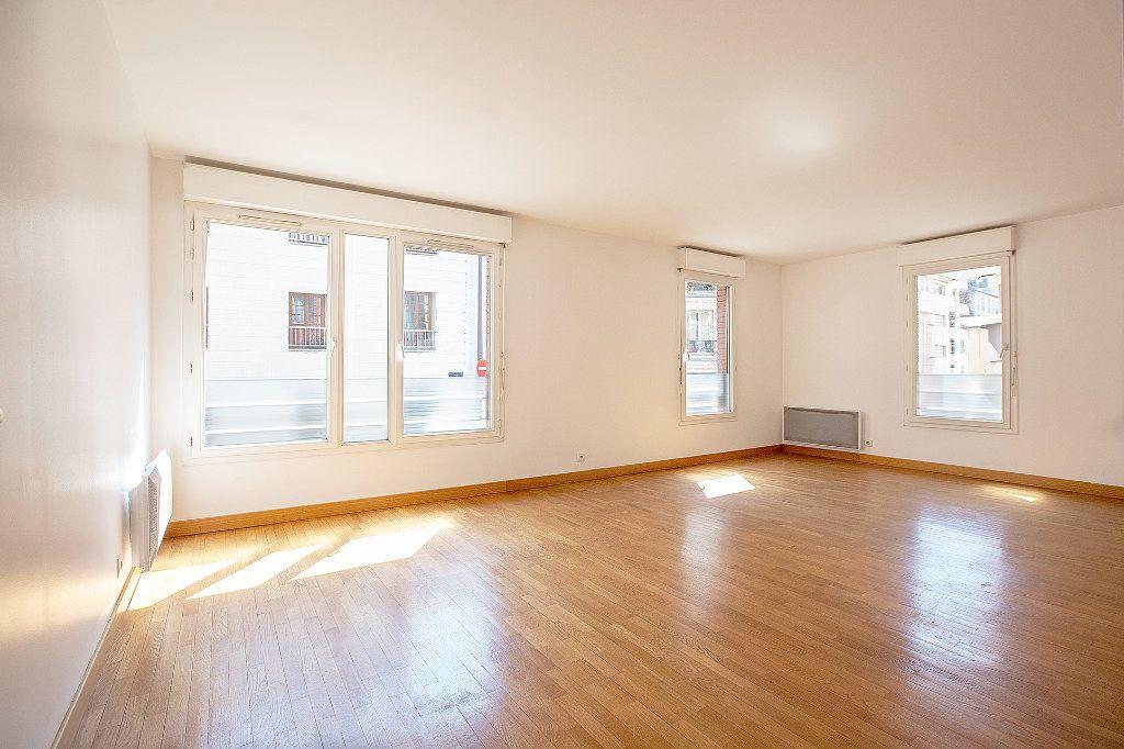 Appartement à vendre 2 56.63m2 à Paris 15 vignette-2