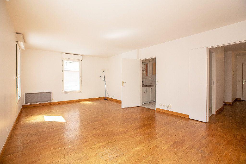 Appartement à vendre 2 56.63m2 à Paris 15 vignette-5