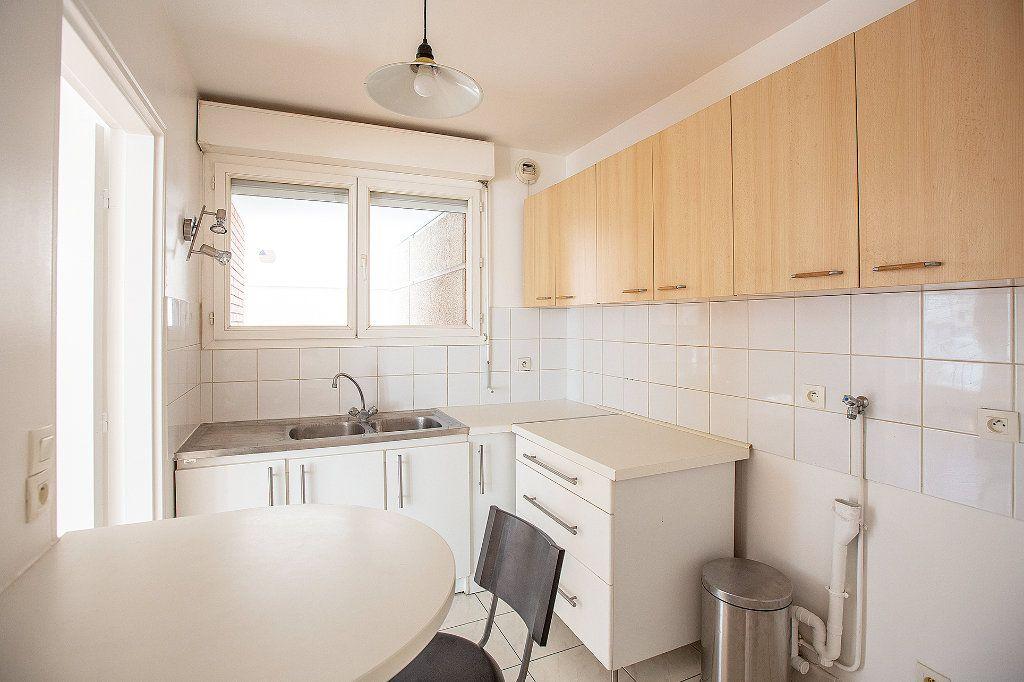 Appartement à vendre 2 56.63m2 à Paris 15 vignette-7