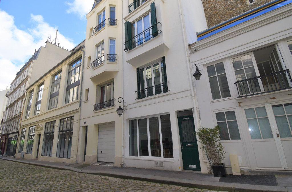 Appartement à louer 1 29.1m2 à Paris 8 vignette-1