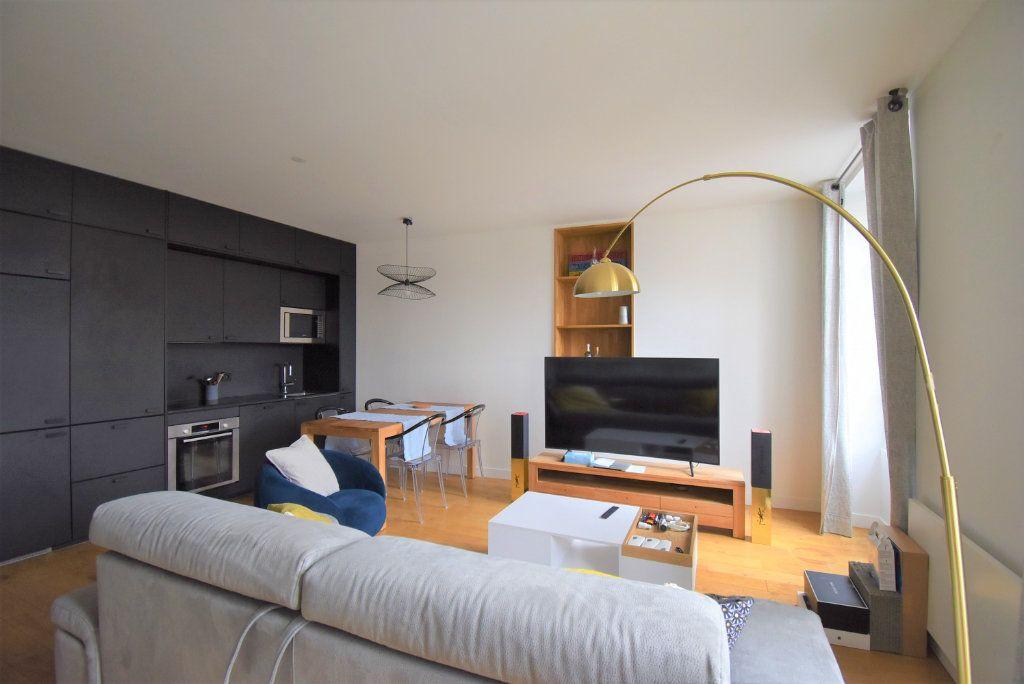 Appartement à louer 2 45.93m2 à Paris 1 vignette-1