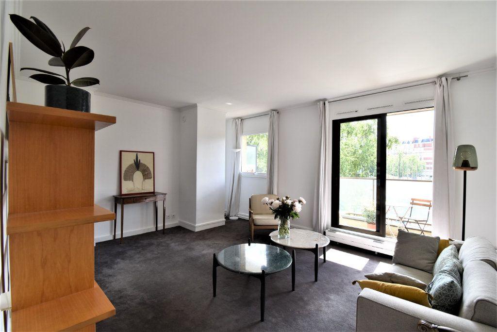 Appartement à vendre 3 69.48m2 à Paris 17 vignette-2