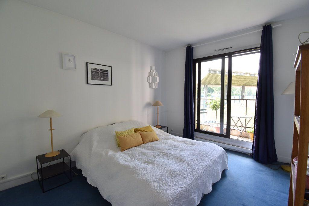 Appartement à vendre 3 69.48m2 à Paris 17 vignette-7