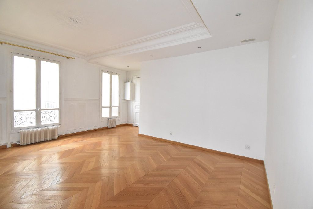 Appartement à louer 3 66.97m2 à Paris 17 vignette-1